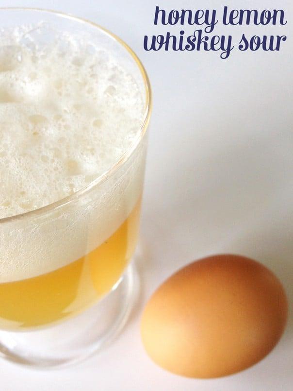 a honey lemon whiskey sour with an egg