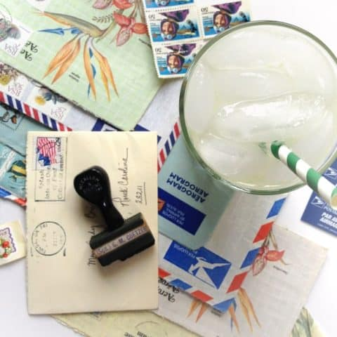 airmail cocktail with a pile of mail
