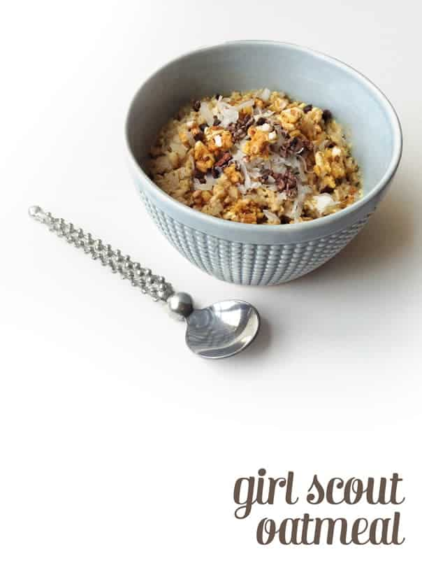 caramel delight oatmeal in a light blue bowl with a silver spoon