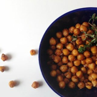 garlic roasted chickpeas in a blue bowl