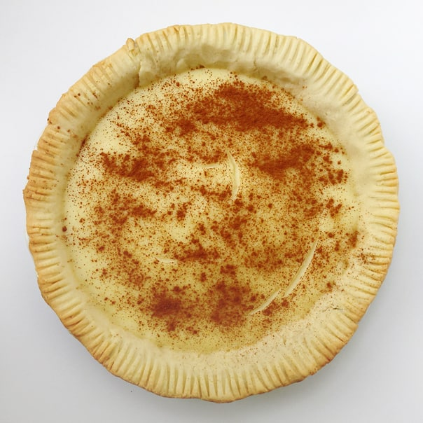 top view of a melktert topped with a sprinkle of cinnamon