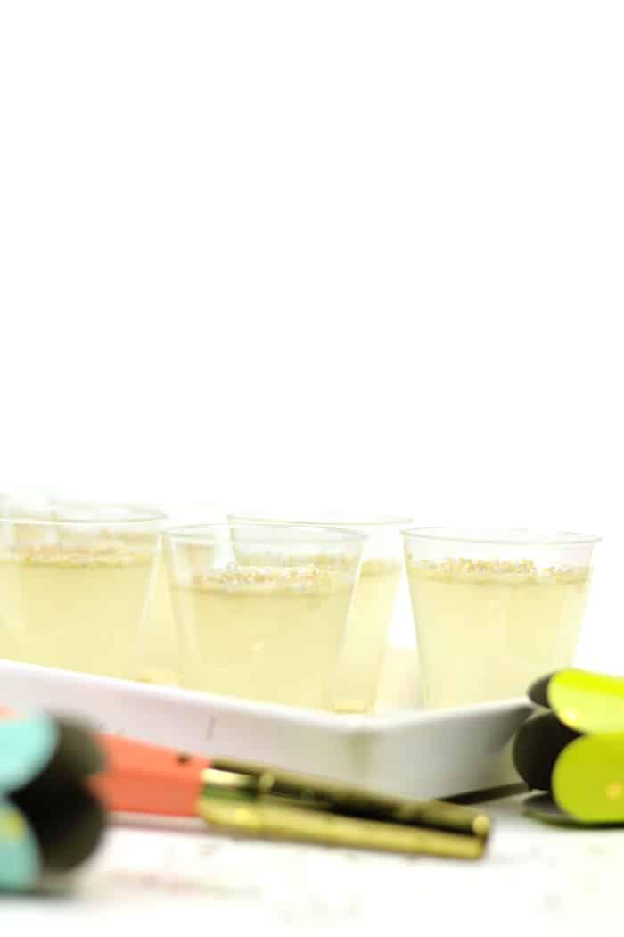 champagne jello shots served on a white ceramic tray