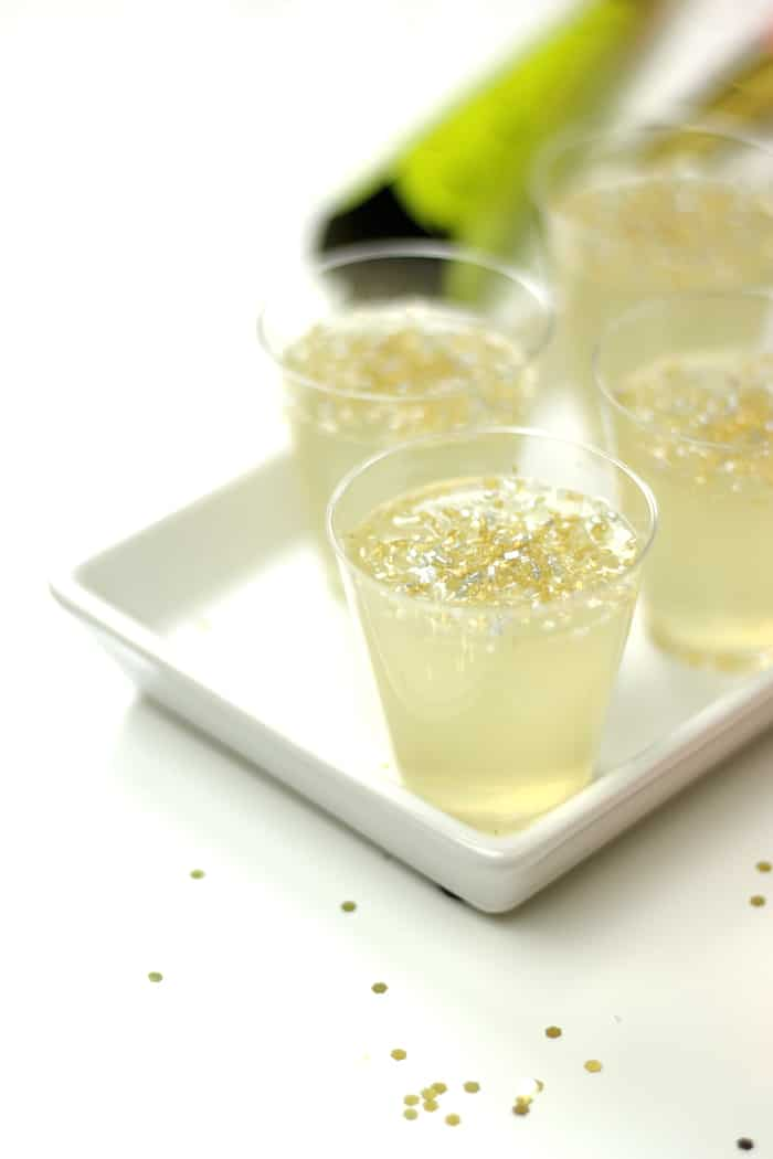 champagne jello shots on a white tray for serving on new years eve