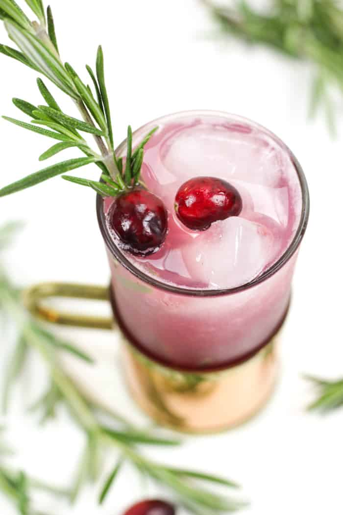 Based on the traditional Moscow Mule, the Yule Mule is a holiday cocktail featuring ginger beer and cranberry juice. Garnish it with rosemary and fresh cranberries for a cocktail that tastes just like Christmas! (via feastandwest.com)