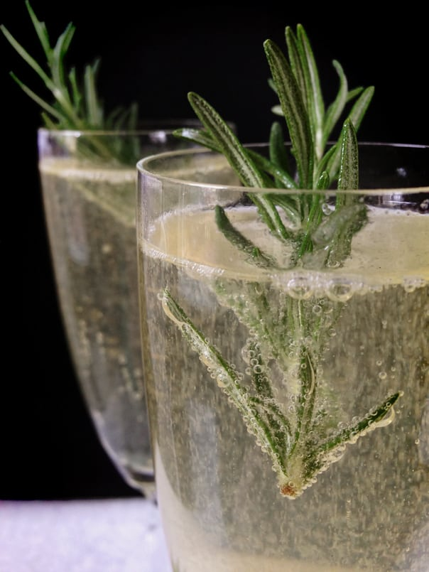 Rosemary Sparkler, a rosemary champagne cocktail made with rosemary simple syrup and vodka // Feast + West
