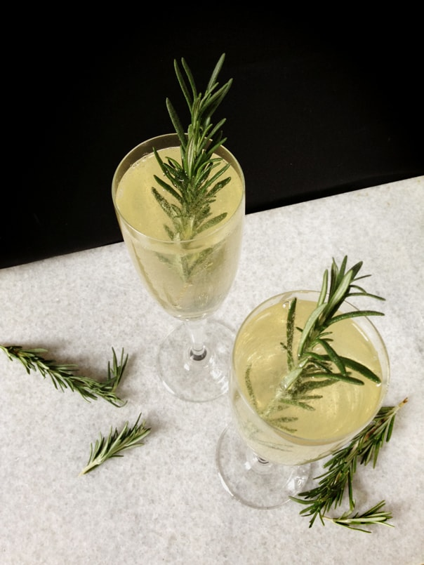 Rosemary Sparkler, a rosemary champagne cocktail made with rosemary simple syrup and vodka. (via feastandwest.com)
