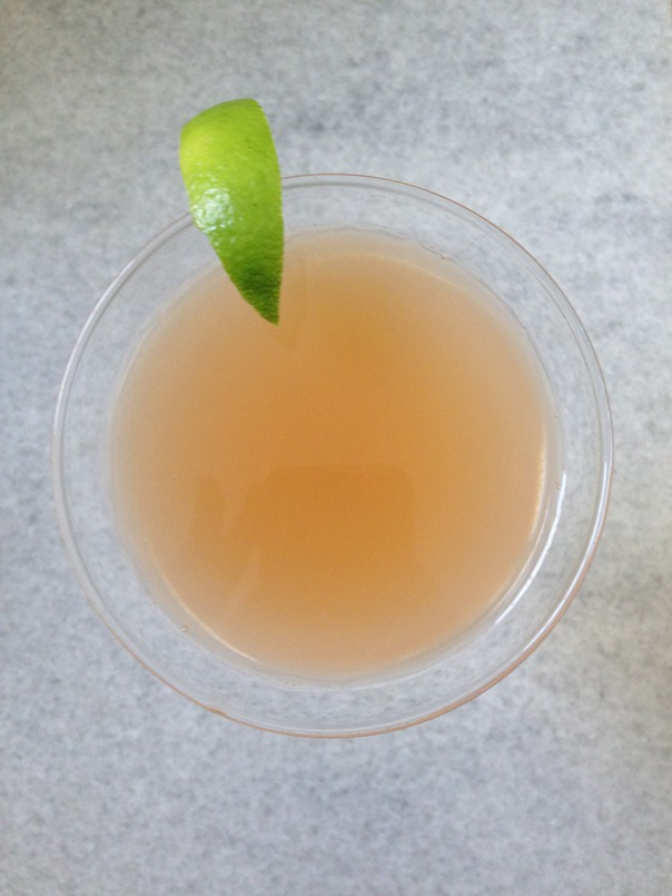 top view of a Guava Cosmopolitan with lime garnish