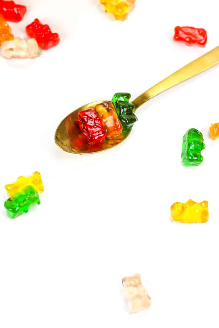 drunken gummy bears on a gold spoon
