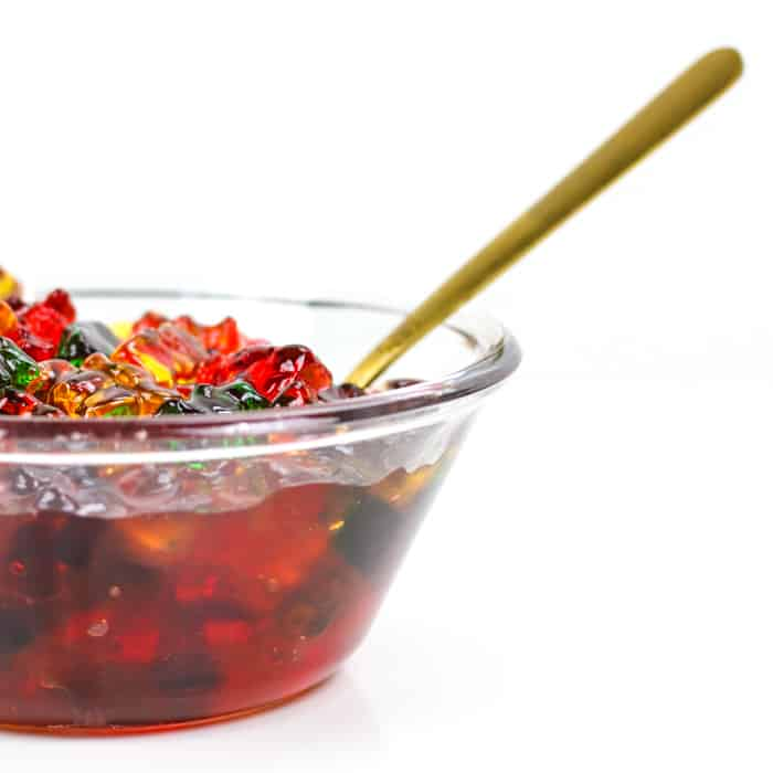 a bowl of gummy bears soaking in alcohol