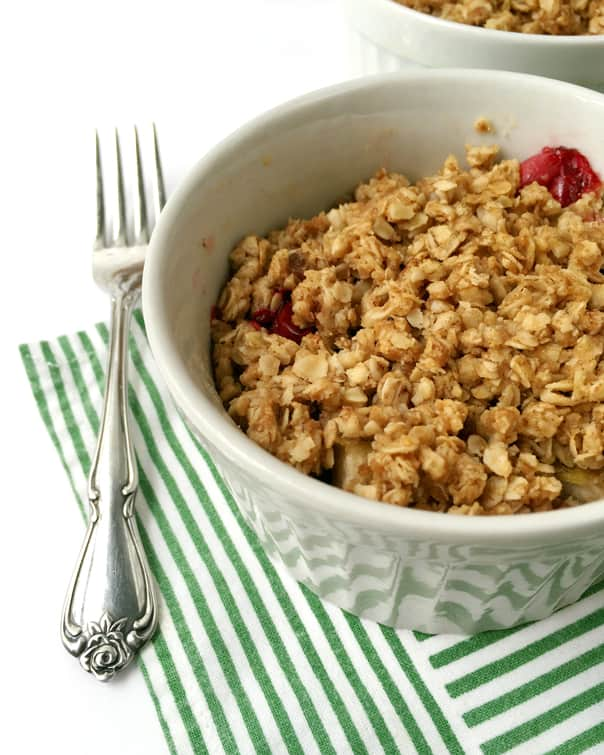 Mini Cranberry Apple Casserole, a sweet and tart side for your Thanksgiving dinner. It's like baked apples and cranberry sauce all in one. // feastandwest.com