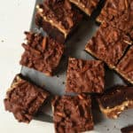 These tri-layer Chocolate Peanut Butter Pretzel Brownies are a decadent dessert for parties! (feastandwest.com)