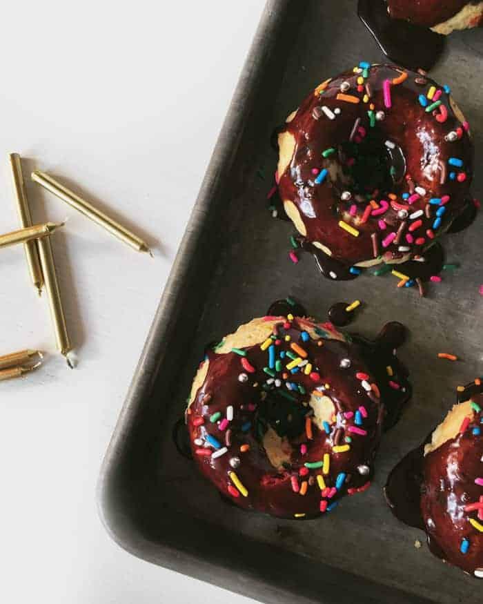 Make Baked Birthday Cake Donuts for a birthday breakfast or dessert. (via feastandwest.com)