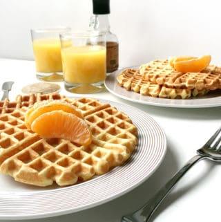 Orange Waffles and Vanilla Bean Butter make for an impressive breakfast menu! (via feastandwest.com)