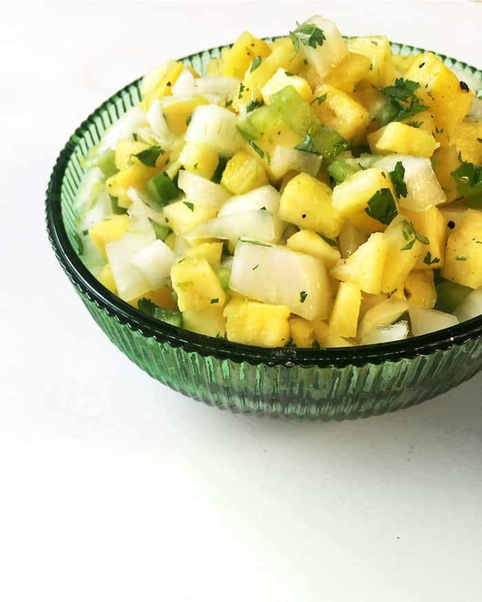 Pineapple Cilantro Salsa is colorful, chunky dip that's packed with flavor — perfect for Cinco de Mayo! (via feastandwest.com)