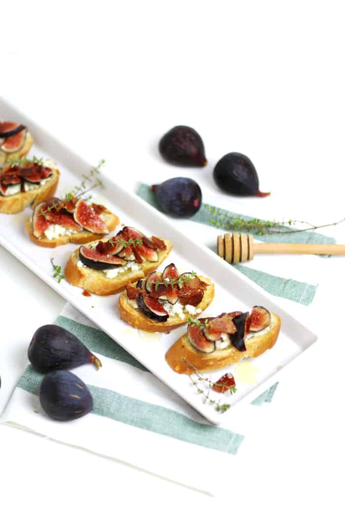 Fig, Goat Cheese, Bacon + Honey Crostini make for a flavorful bite to serve at a late-summer gathering. (via feastandwest.com)