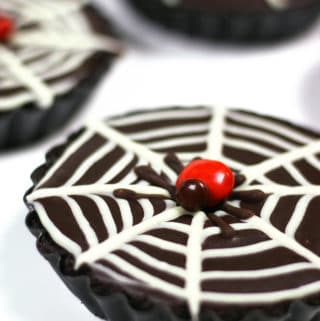 These Mini Chocolate Ganache Spiderweb Tarts are just the right mixture of spooky, innocent and elegant. They are the perfect dessert for a black-and-white Halloween party or dinner. (via feastandwest.com)