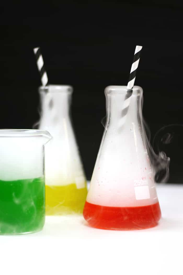 Eery and colorful, these Mad Scientist Cocktails make for a fun Halloween party drink. Impress all your guests when you mix Skittles-infused vodka with soda and add dry ice to make it bubble and spurt! (via feastandwest.com)