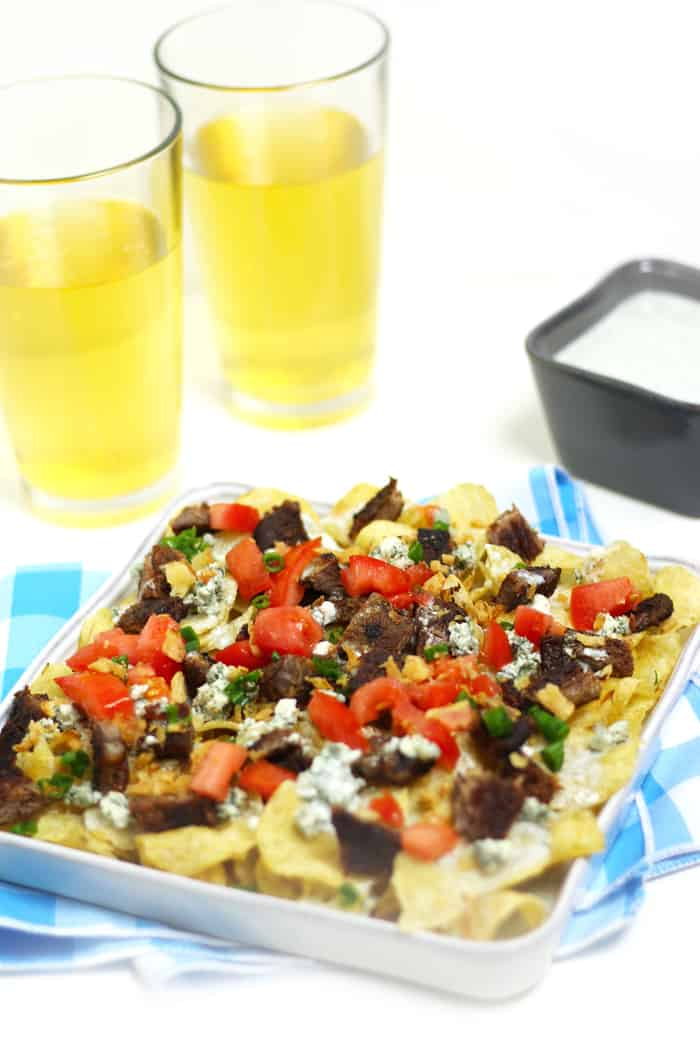 Blackened Steak + Blue Cheese Nachos are a glorious snack for game day. Steak cooked on the grill or in a skillet is served atop a bed of potato chips and blue cheese queso. (via feastandwest.com)