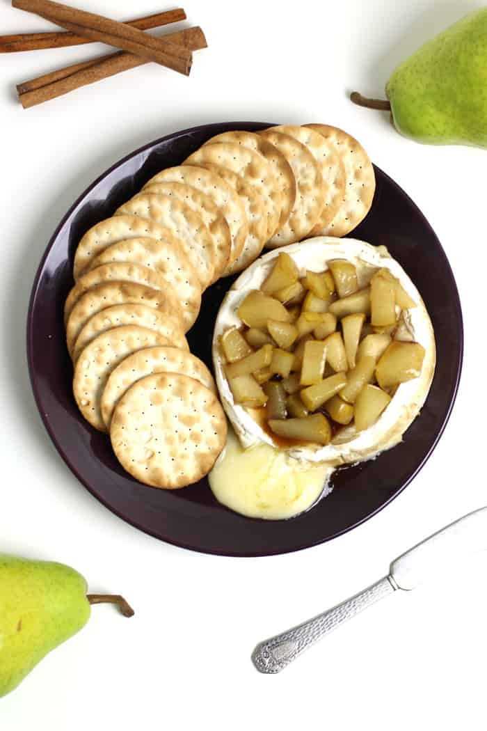 Planning the best New Year's Eve party ever? Don't forget the snacks! Caramelized Pear Baked Brie is always a popular winter appetizer for a crowd. (via feastandwest.com)