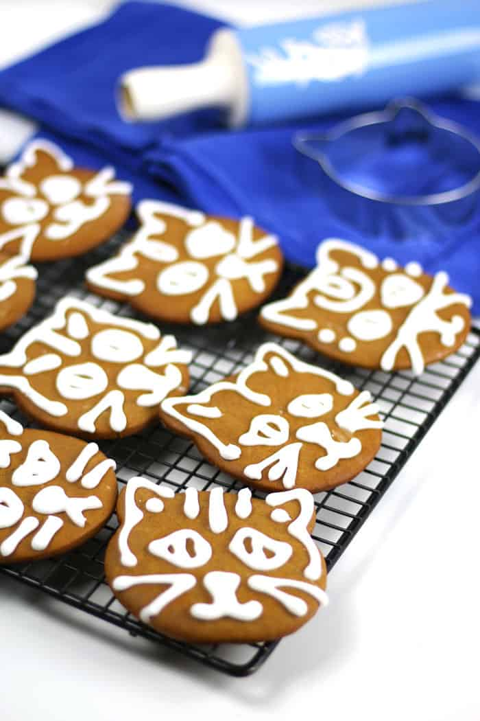 Cardamom Ginger Cat Gingerbread Cookies are the best and quirkiest way to celebrate the holidays. Bursting with baking spices, anyone who bites into these Christmas cookies will love all the flavor and chewy texture. The cat cookie cutter is a cute and untraditional touch, and royal icing makes them official. #sweetestseasoncookies