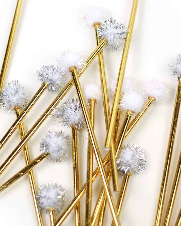 These cute Pom-Pom Drink Stirrers are a fun DIY for the holidays! They'll look so festive in a glass of champagne as you ring in the new year with friends! (via feastandwest.com)
