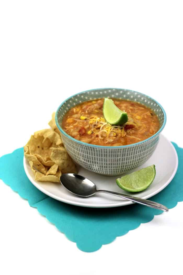 Leftover chicken makes a great comeback in this comforting Quick Southwestern Chicken Chili. Onion, tomatoes, corn, white beans, rice and pulled chicken come together in this easy chili recipe. Topped with cheese and served with lime wedges and tortilla chips, a big bowl of this soup is a surefire cure for the winter blues. (via feastandwest.com)