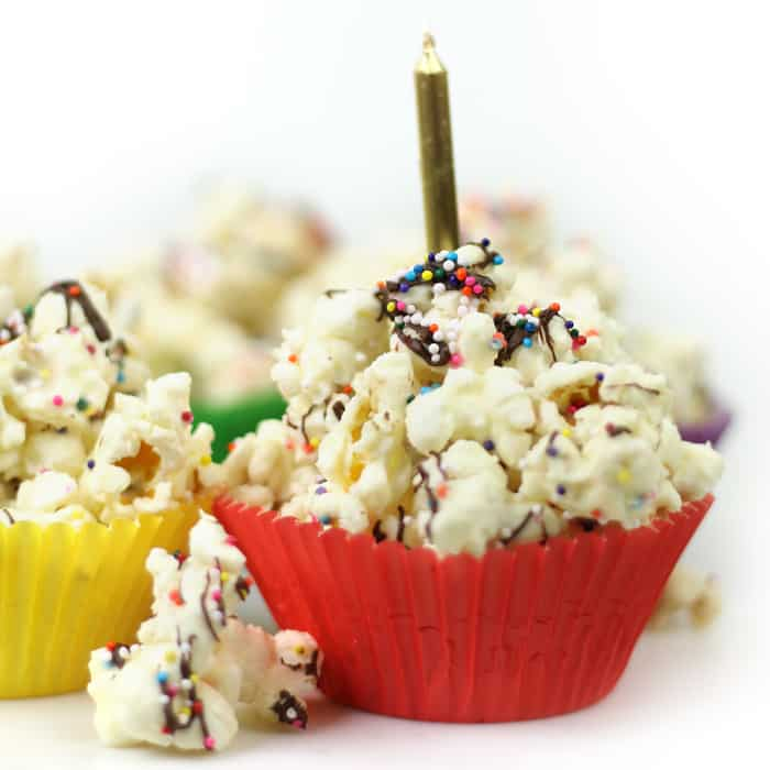 Every celebration deserves Chocolate Birthday Cake Popcorn! Sprinkle-coated popcorn with melted almond bark and chocolate make for a colorful and sweet party snack. (via feastandwest.com)