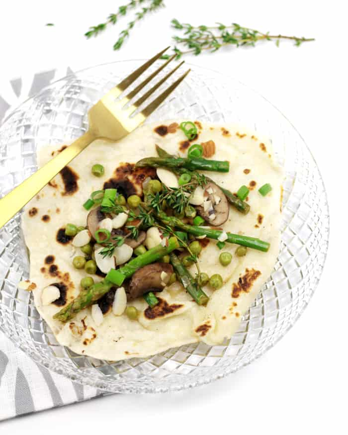 Filled with green goodness, try these Vegan Spring Vegetable Potato Crepes at your next brunch or dinner feast this spring. You totally won't believe these crepes contain potatoes! Based on Norwegian lefse, these are thin, vegan pancakes made from riced russet potatoes, flour, salt and vegan butter. The filling contains a bevy of spring vegetables — asparagus, peas, mushrooms and shallots — and is flavored with garlic, lemon and thyme. (via feastandwest.com)