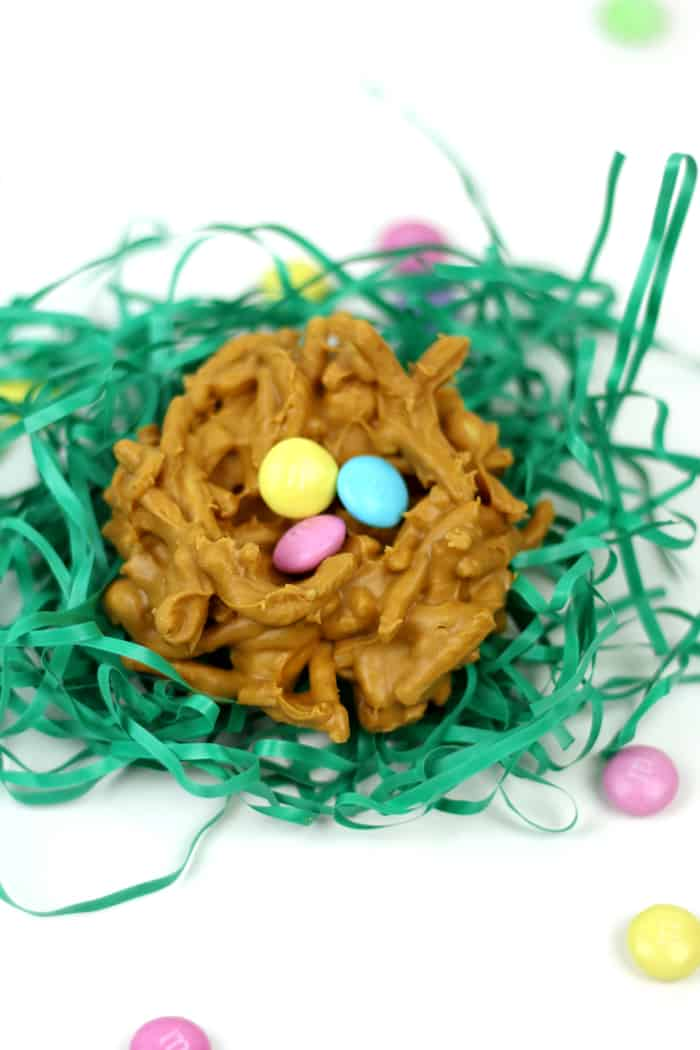 """Whimsical and colorful, these Peanut Butter Butterscotch Nest Cookies are an adorable seasonal treat. Made with M&M'S® Milk Chocolate as the """"eggs,"""" serve these at any spring gathering or gift them in an Easter basket! AD (via feastandwest.com)"""