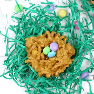 """Whimsical and colorful, these Peanut Butter Butterscotch Nest Cookies are an adorable seasonal treat. Made with M&M'S® Milk Chocolate as the """"eggs,"""" serve these at any spring gathering or gift them in an Easter basket! (via feastandwest.com)"""