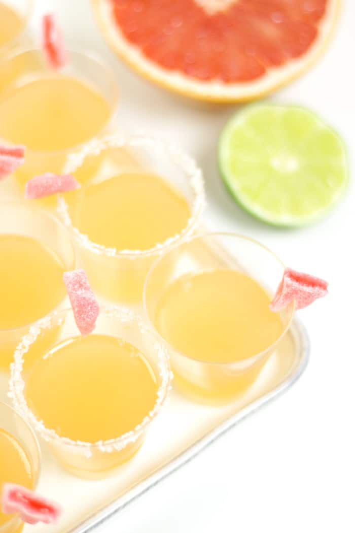 From Cinco de Mayo to the end of summer, celebrate everything with a round of Paloma Jello Shots! Packed with delightful grapefruit flavor, give these tiny tequila treats a salted rim and a cute candy garnish. (via feastandwest.com)