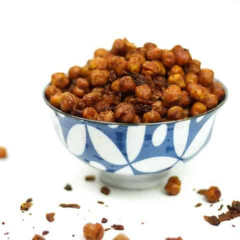 Spicy Bacon Roasted Chickpeas bring the sizzle to soups, salads and snacktime. Habanero hot sauce offer quite a flavor kick, and a big batch of these chickpeas makes for an easy, on-the-go nibbling. (via feastandwest.com)