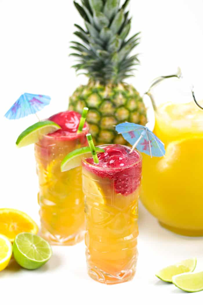 Time for a tiki party! Serve up a pitcher of this fruity Pineapple Mango Tiki Punch with a scoop of raspberry sorbet. It stars a homemade spiced and Tropicana®Premium Pineapple Mango with Lime drink. (via feastandwest.com)