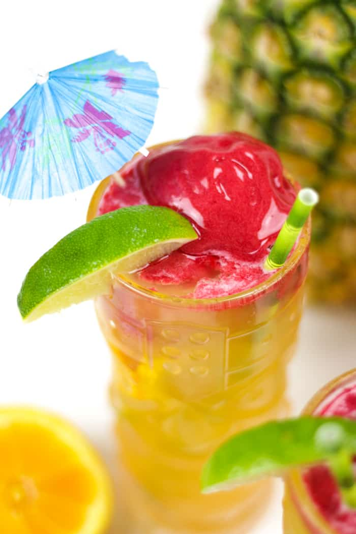 Time for a tiki party! Serve up a pitcher of this fruity Pineapple Mango Tiki Punch with a scoop of raspberry sorbet. It stars a homemade spiced rum and Tropicana®Premium Pineapple Mango with Lime drink. (via feastandwest.com)