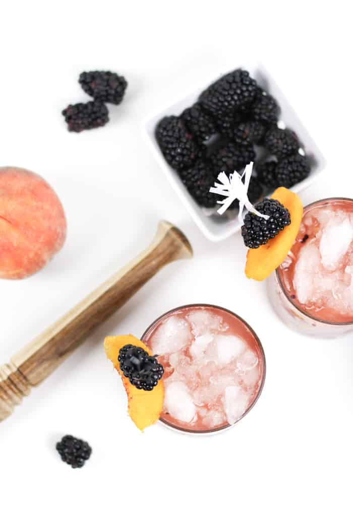 Sip on a Blackberry Peach Bramble. Made with fresh blackberries, peaches and honey, plus fragrant gin, this cocktail is the farmers market in a glass.(via feastandwest.com)