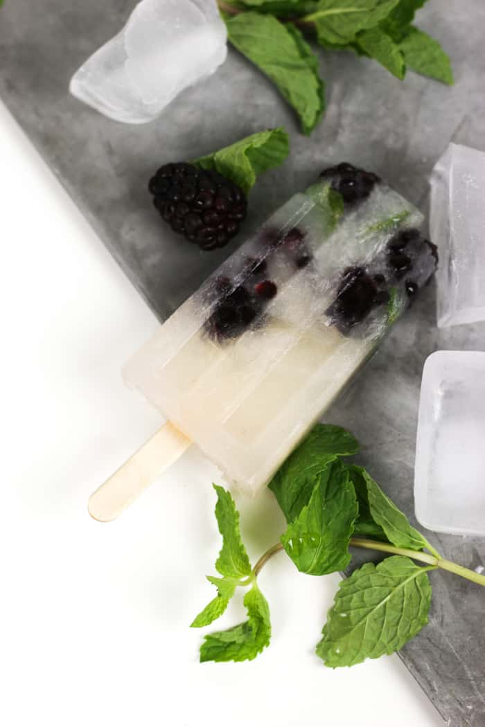 Soak up the sun and rum with a batch of Blackberry Mojito Popsicles. They're a boozy, zesty, frozen treat starring fresh blackberries, lime, mint and rum. (via feastandwest.com)