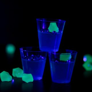 Light up your Halloween party with a round of boozy Glow in the Dark Jello Shots! These classy gelatin treats taste just like a gin and tonic OR a vodka tonic with lime! Delight your guests with this tricky spin on a Halloween cocktail. (via feastandwest.com)