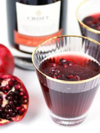 Say cheers with a Sparkling Pomegranate Port Wine Cocktail! This rutilant drink marries the sweetness of Port wine with tart pomegranate and a hint of orange flavor, topped with a bit of bubbly champagne. (via feastandwest.com)