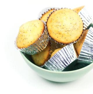 orange poppy seed muffins in a green bowl