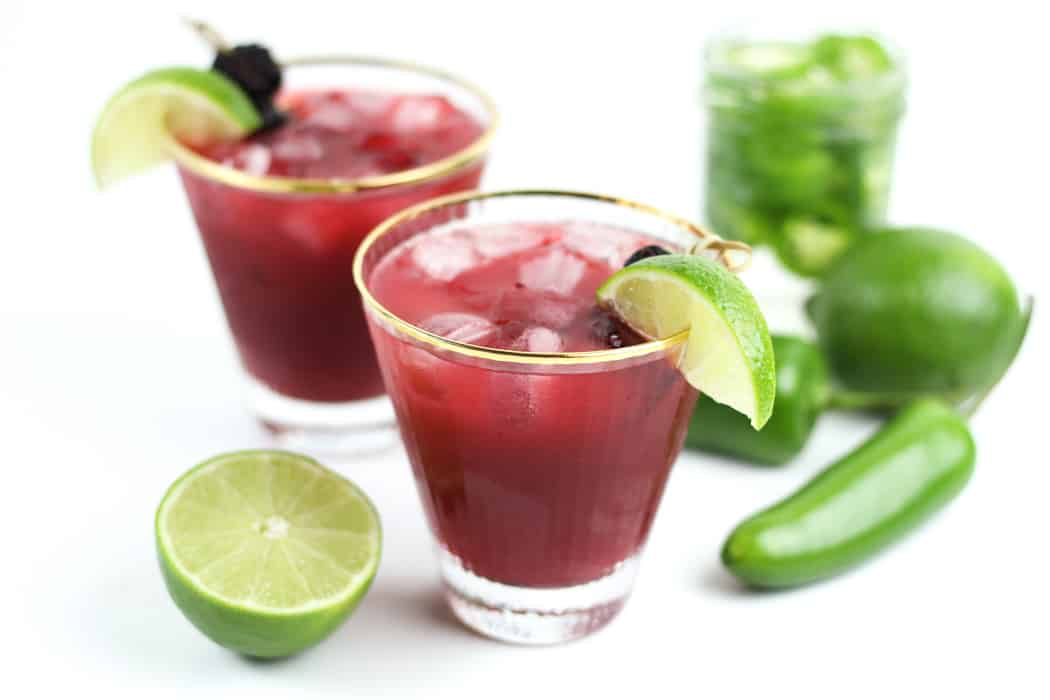 Spicy Jalapeño Blackberry Margaritas really hit all the taste buds so you can savor ever single sip. Make it with homemade jalapeño-infused tequila and tailor them with your desired amount of heat. Cheers to summertime!(via feastandwest.com)
