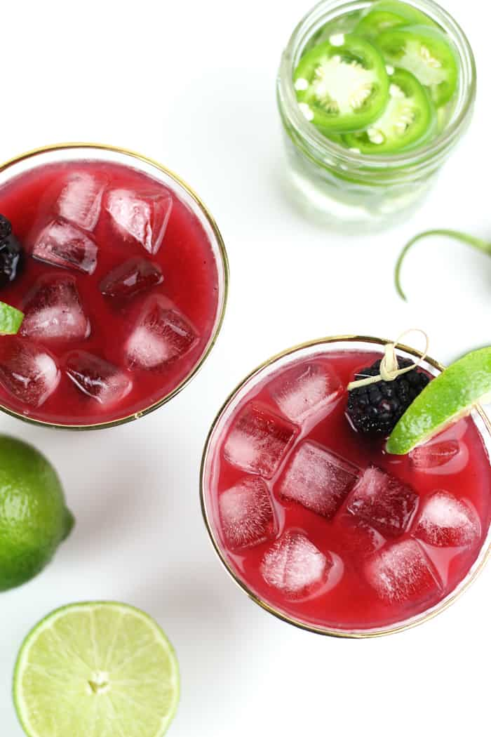 Spicy Jalapeño Blackberry Margaritas really hit all the taste buds so you can savor every single sip. Make it with homemade jalapeño-infused tequila and tailor them with your desired amount of heat. Cheers to summertime!(via feastandwest.com)