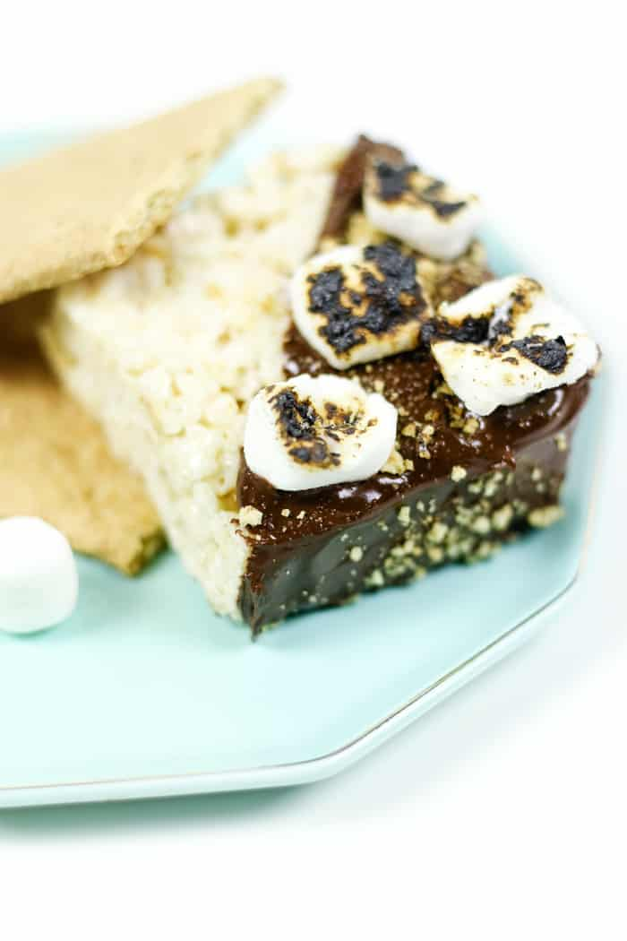 Make S'mores Rice Krispies Treats for a party to enjoy all the pleasures of camping in one easy, no-bake dessert. Cereal bars are dipped in melted chocolate, then topped with graham cracker crumbs and toasted marshmallows. (via feastandwest.com)