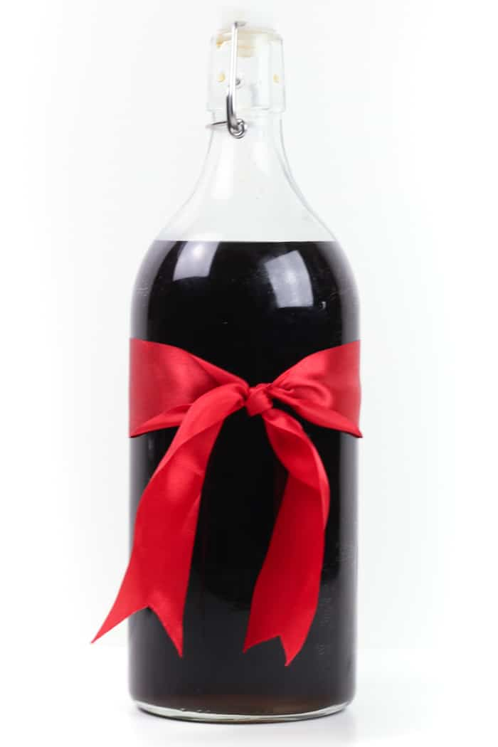 Homemade Coffee Liqueur makes a sweet holiday gift for all the coffee lovers in your life! All you need is vodka or rum, vanilla simple syrup, fresh brewed coffee and a jar or bottle, and this popular spirit is yours to gift or drink!