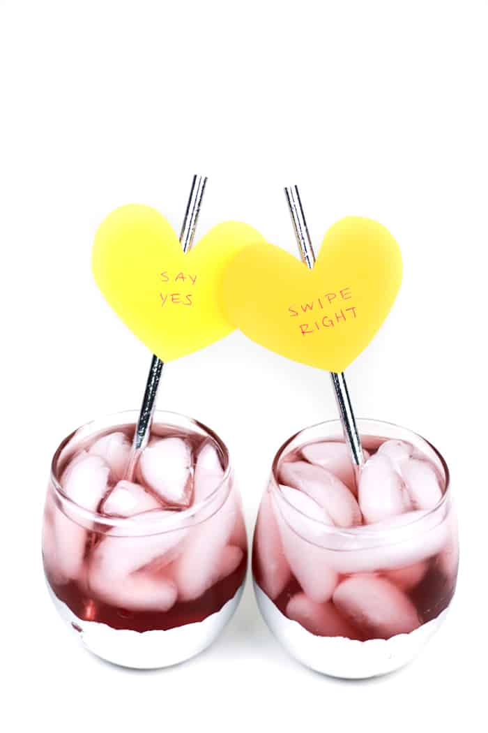 Send a message to your valentine or galentine with the cutest DIY Conversation Heart Cocktail Stirrers! These easy paper drink decorations can make a colorful statement to any beverage! (via feastandwest.com)