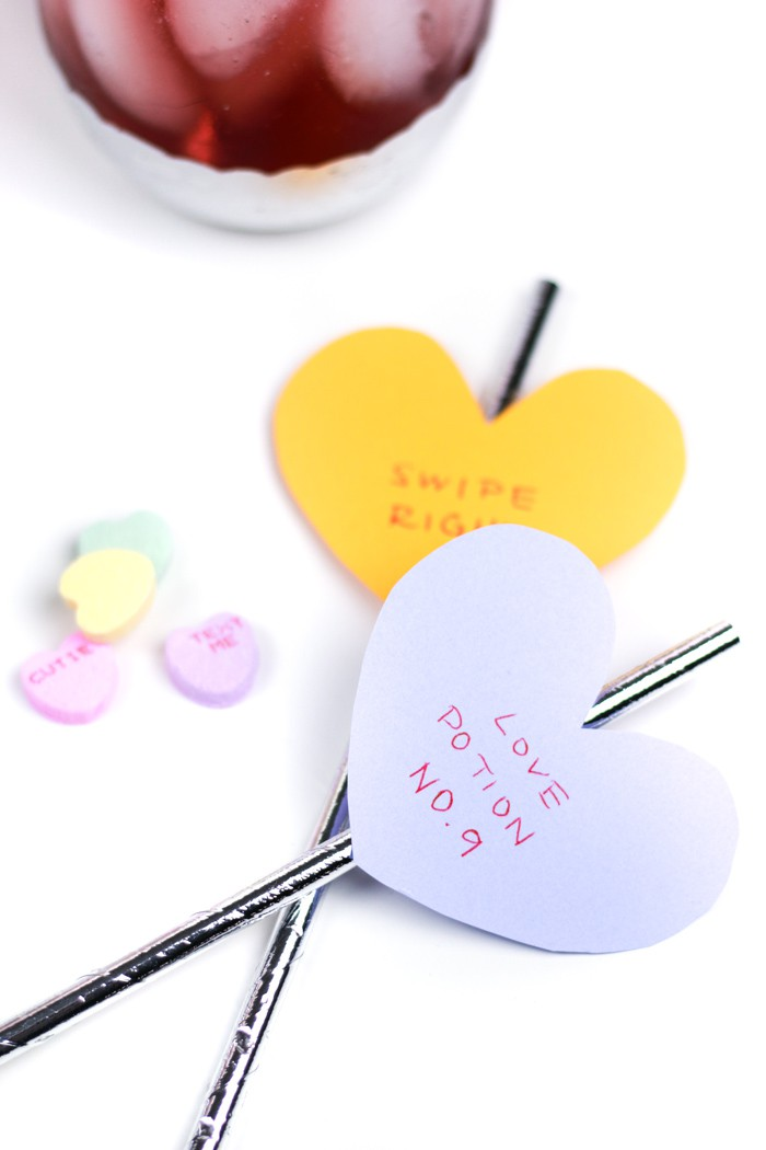 Send a message to your valentine or galentine with the cutest DIY Conversation Heart Cocktail Stirrers! These easy paper drink decorations can make a colorful statement to any beverage!(via feastandwest.com)