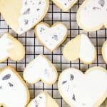 Heart-Shaped Sugar Cookie Cutouts with Royal Icing and Edible Silver Leaf