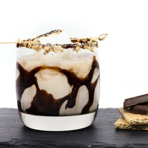 Kick back this summer with a S'mores White Russian. It's everything you want in a s'mores cocktail — complete with marshmallow vodka and graham cracker milk and garnished with a chocolate drizzle, graham cracker crumbs and toasted marshmallows. (via feastandwest.com)