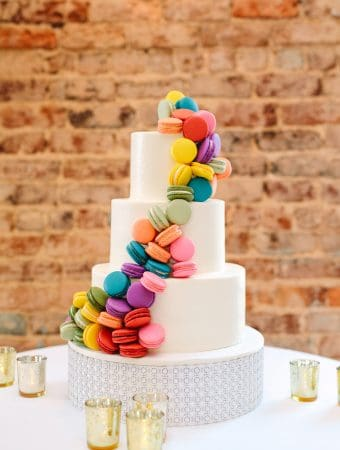 Our wedding cake with colorful macarons