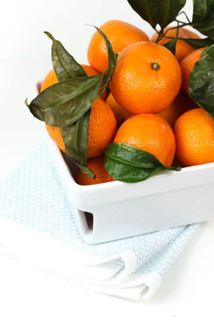 mandarin oranges in a ceramic container