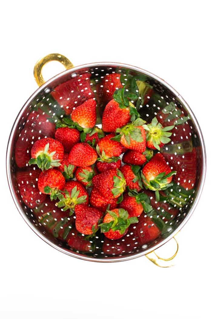 washed strawberries in a colander